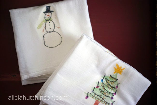Use kids' art to personalize kitchen towels to create great gifts!